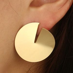 Gold toned stud circular abstract earrings